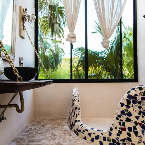 king room with terrace and jungle view bathroom