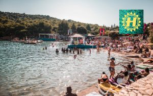 people swimming at hospitality on the beach festival