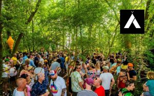 people dancing in forest at alfresco festival